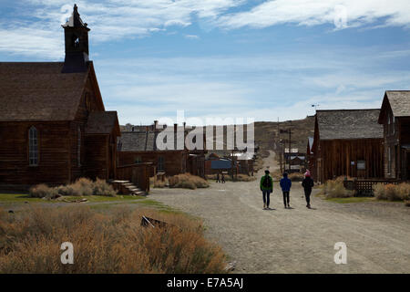 Methodist Church and tourists, Green Street, Bodie Ghost Town, Bodie Hills, Mono County, Eastern Sierra, California, - Stock Photo