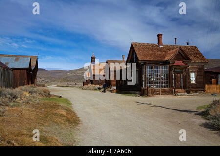 Tourist on Green Street, Bodie Ghost Town ( elevation 8379 ft / 2554 m ), Bodie Hills, Mono County, Eastern Sierra, - Stock Photo