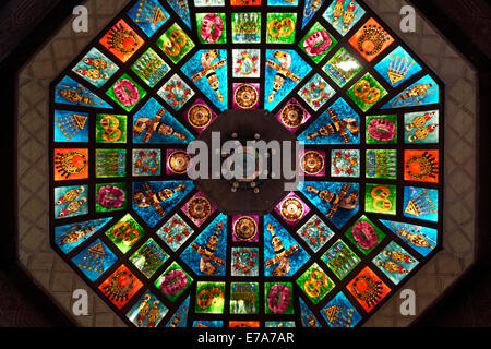 Glass dome, ornate stained glass skylight in the Muttrah Souq market, Muttrah, Muscat, Oman - Stock Photo