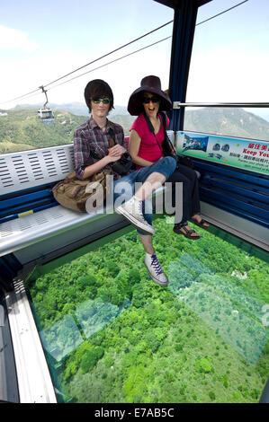 Skyrail gondola with glass floor, Hong Kong, China. - Stock Photo
