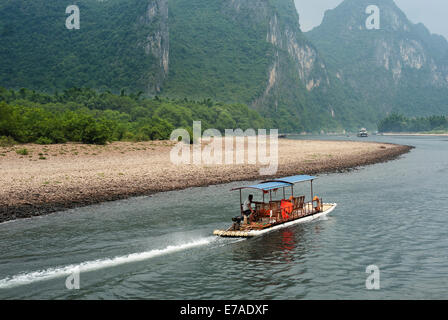 Small tourist boat on the Li River, China - Stock Photo