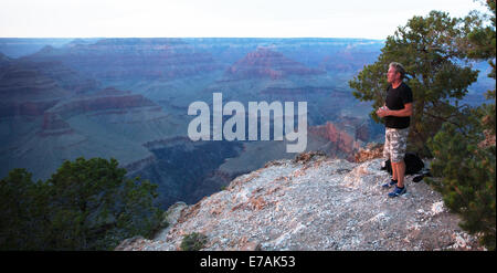 Man standing on the edge of the Grand Canyon, USA - Stock Photo