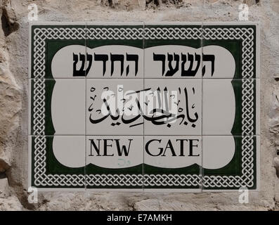 Sign on ceramic tiles in English Hebrew and Arabic at the New Gate in the old city East Jerusalem Israel - Stock Photo