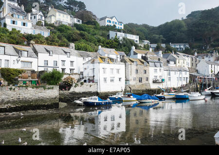 Fishermen's houses and boats in the historic fishing village of Polperro, Cornwall - Stock Photo