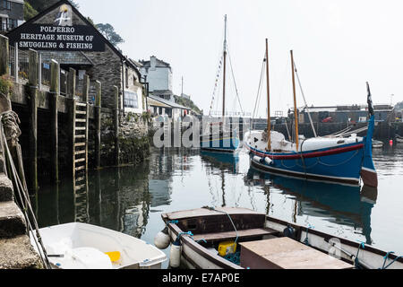 Fishermen's houses and fishing boats in the historic fishing village of Polperro, Cornwall - Stock Photo