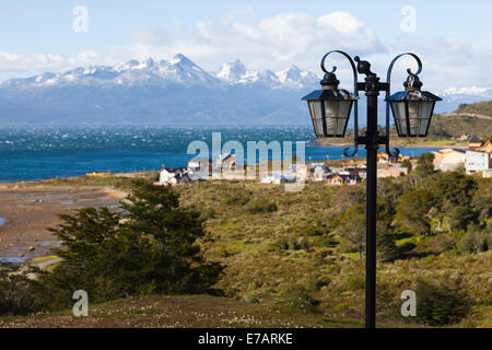Lamp post against a coastal landscape, Ushuaia, Tierra del Fuego, Antártida e Islas del Atlántico Sur Province, - Stock Photo