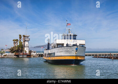Cruise boat Harbor Emporor, of the Blue and Gold Fleet, returns to its berth in San Francisco Bay near Pier 39, - Stock Photo