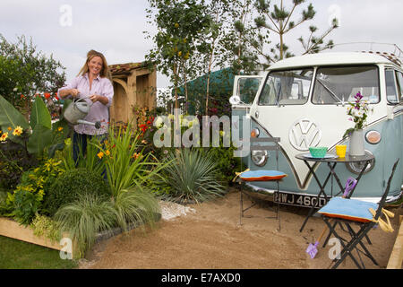 VW Volkswagan campervan at Harrogate, Yorkshire, UK. 11th Sept, 2014.  Samantha Guthrie, watering plants at the - Stock Photo