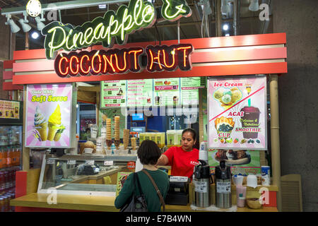 Hawaii Hawaiian Honolulu Ala Moana Center mall shopping Makai Market food court Pineapple & Coconut Hut counter - Stock Photo
