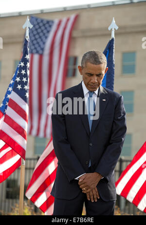 Washington DC, USA. 11th Sep, 2014. United States President Barack Obama bows his head during a ceremony at the - Stock Photo