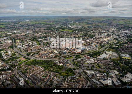An aerial view across the centre of Oldham, Greater Manchester. Open countryside is visible in the distance. - Stock Photo