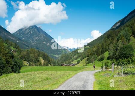 PRAZ-DE-FORT, SWITZERLAND - AUGUST 30: Ultra Trail du Mont Blanc competitors running on valley. The ultra-marathon takes on aver
