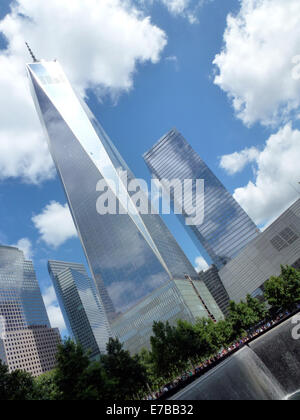 Clouds mirror on the glass facade of the  One World Trade Center (1st WTC), formerly known as Freedom Tower, and - Stock Photo
