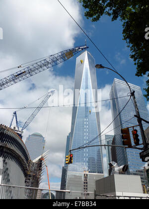 Clouds mirror on the glass facade of the  One World Trade Center (1st WTC, C), formerly known as Freedom Tower, - Stock Photo