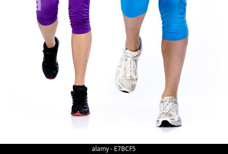 Close-up photo of two woman's legs running - Stock Photo