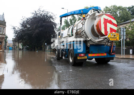 Lorry waiting to pump flood waters In Hebden Bridge, West Yorkshire - Stock Photo