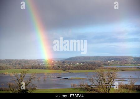 A rainbow ends on flooded farmland near Muchelney in Somerset. 4 Feb 2014 - Stock Photo
