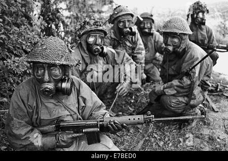 NATO exercises in Germany, British Army soldiers in NBC suit (September 1984) - Stock Photo