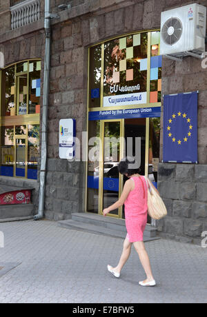 A woman walks past the information centre of the European Union in the Armenian capital Yerevan on 28 June 2014. - Stock Photo