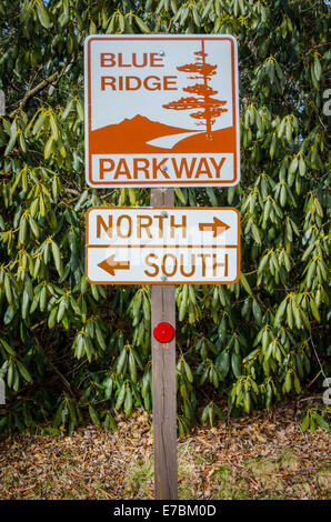An entrance sign to the Blue Ridge Parkway points tourists to the north and south - Stock Photo