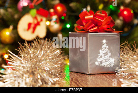 Christmas gift set with colorful bokeh background - Stock Photo