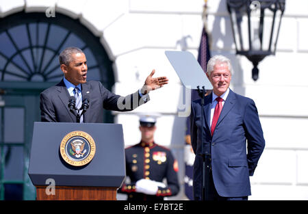 Washington, DC, USA. 12th Sep, 2014. U.S. President Barack Obama (L) and former President Bill Clinton (R) attend - Stock Photo