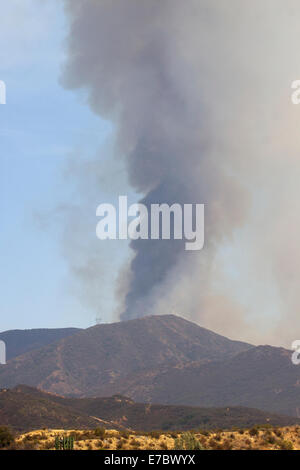 Fire fighters battled a brush fire Friday morning in Orange County's Silverado Canyon in the Cleveland National - Stock Photo