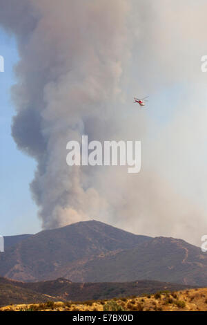Firefighters battled a brush fire Friday morning in Orange County's Silverado Canyon in the Cleveland National Forest - Stock Photo