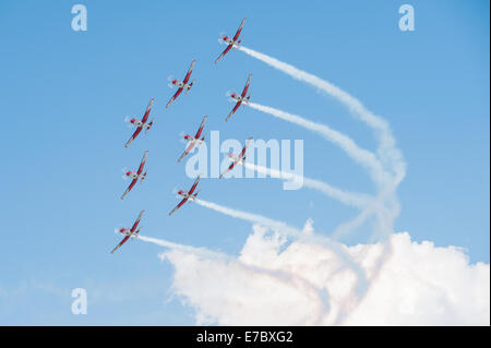 PAYERNE, SWITZERLAND - SEPTEMBER 6: Flight of PC-7 aerobatic team in close formation on AIR14 airshow in Payerne, - Stock Photo