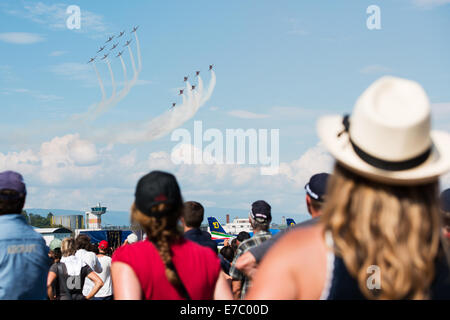PAYERNE, SWITZERLAND - SEPTEMBER 7: Spectators look at anniversary flight of PC-7 and Patrouille Suisse aerobatic - Stock Photo