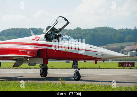 PAYERNE, SWITZERLAND - SEPTEMBER 7: Pilot of Patrouille Suisse aerobatic team waves to spectators of Air14 show - Stock Photo