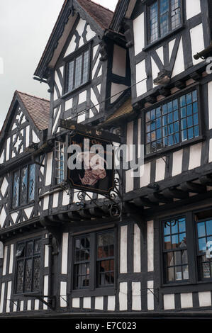 Tudor buildings of a medieval inn, the Bull Ring Tavern, in Ludlow, Shropshire - Stock Photo