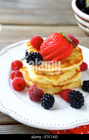 Pancakes with sweet berries, food closeup - Stock Photo