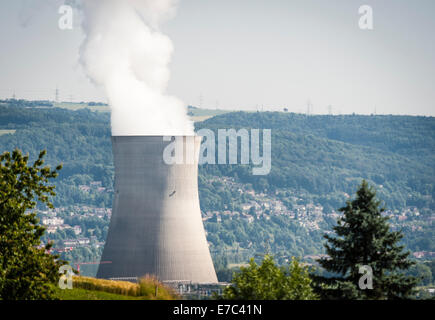 Northbound view from the hills of canton Aargau, Switzerland, onto the cooling tower of the Swiss nuclear power - Stock Photo