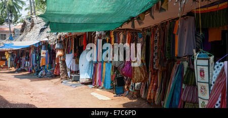 Clothes on sale at a market on the clifftom in the Indian tourist town of Varkala, Kerala State. - Stock Photo