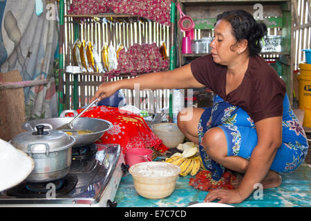 Frying banana's in the Floating village on the Tempe lake in Sulawesi, Indonesia - Stock Photo