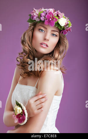 Exquisite Woman with Wreath of Flowers. Elegant Lady with Frizzy Hair - Stock Photo