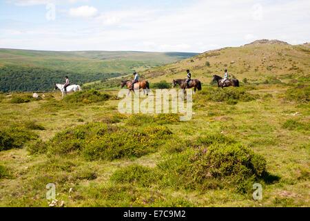 People riding horses by Sharp Tor, Dartmoor national park, Devon, England - Stock Photo