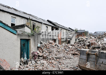 Derelict terraced houses ready to be demolished to make way for new homes - Stock Photo