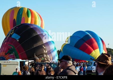 Balloons being inflated and prepped for launch - Stock Photo