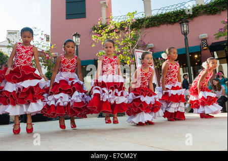 A group of young girls dance on a stage at Paseo Nuevo shopping mall in Santa Barbara during fiesta, or 'Old Spanish - Stock Photo