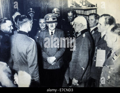 Adolf Hitler among the officers, one of whom is bandaged head. Reproduction of antique photo. 13th Sep, 2014. 1940s - Stock Photo