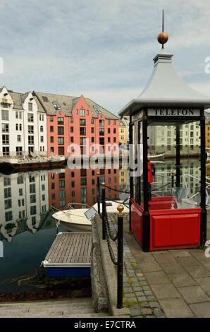 Telephone kiosk beside the inner harbour at Alesund, Norway. - Stock Photo