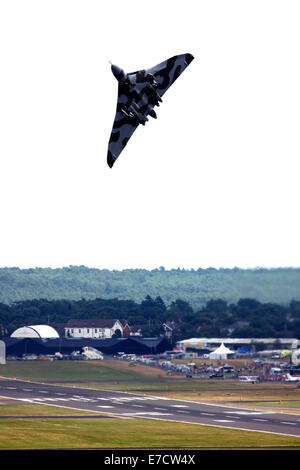 Avro 698 Vulcan B2  strategic bomber taking off at Farnborough International Airshow 2014 - Stock Photo