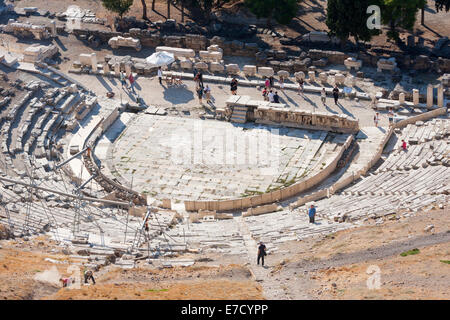ATHENS, GREECE - OCTOBER 6:Tourists sightseeing the Theatre of Dionysus in the Acropolis on October 6th, 2011 in - Stock Photo