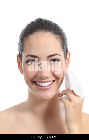 Beautiful woman cleaning face with a facial wipe isolated on a white background - Stock Photo