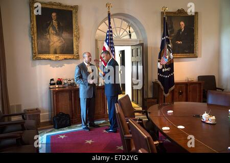 US President Barack Obama talks with Homeland Security Secretary Jeh Johnson after a meeting with Central American - Stock Photo