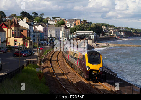 A  Voyager DMU working a Cross Country trains service at Dawlish on the 27th June 2014. - Stock Photo
