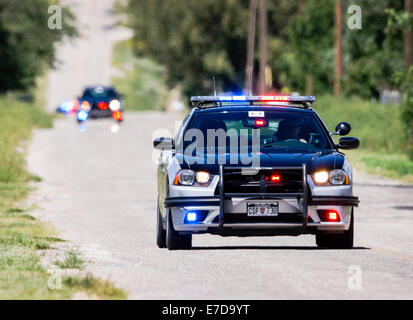 Colorado State Police cars & motorcycles, USA Pro Challenge bike race, Stage 3, central Colorado, USA - Stock Photo