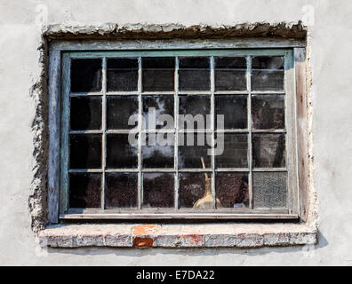 Old wooden window pastel toned grungy wall. - Stock Photo